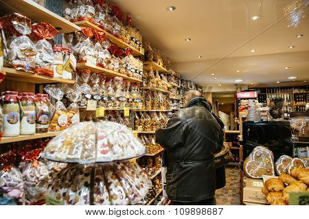 People Buying Christmas Sweets At Christmas Market