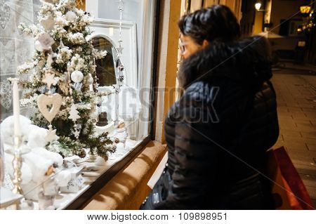 Christmas Shop Window Admired By Woman