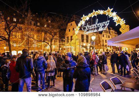People Admiring Neon Sign Christmas Market, Captial De Noel,