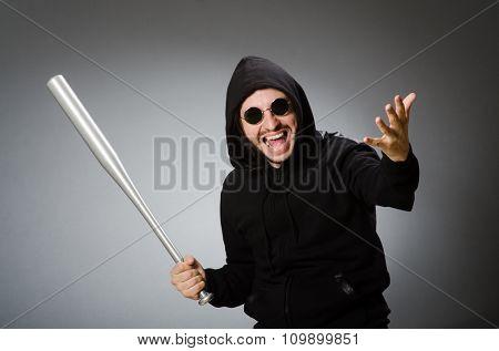 Aggressive man with basebal bat