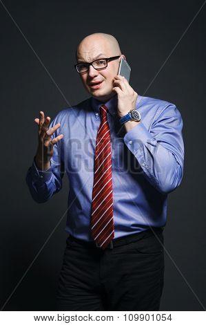 Emotional Businessman Talking On Phone