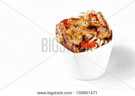 Delicious Wok Noodles Box With Pork And Udon. Chinese And Asian Takeaway Fast Food. Studio Isolated