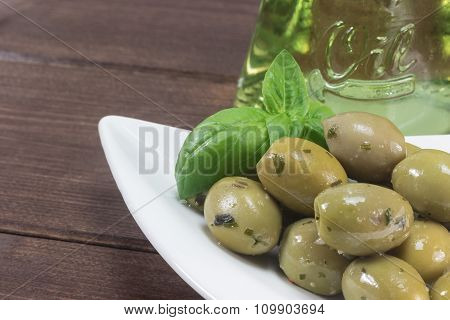 Green Olives With On The Wooden Desk