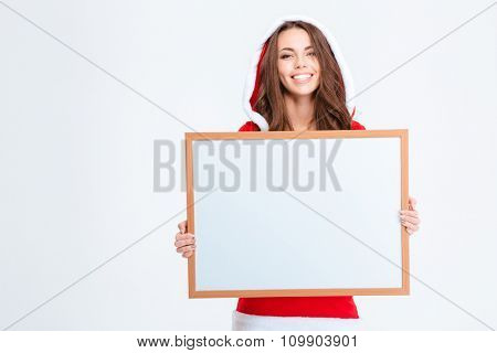 Portrait of a smiling woman in santa claus cloth holding blank board isolated on a white background