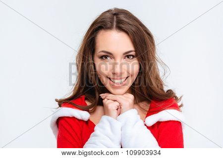 Portrait of beautiful smiling positive girl wearing santa claus clothes on white background