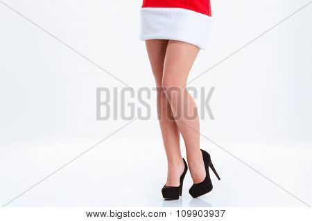 Closeup portrait of a female legs in santa claus cloth isolated on a white bakground