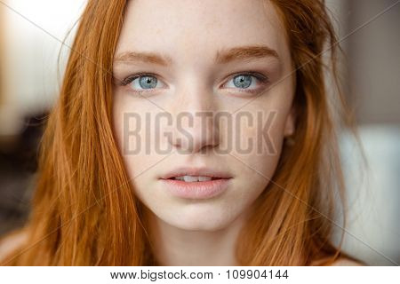 Portrait of tender natural beautiful redhead girl looking camera