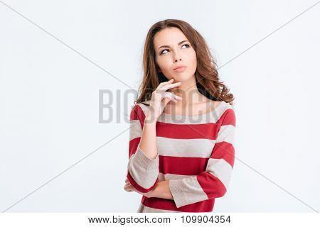 Portrait of a young pensive woman looking away at copyspace isolated on a white background