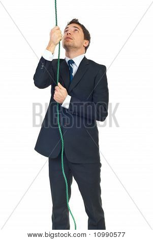 Man Trying To Climbing Rope
