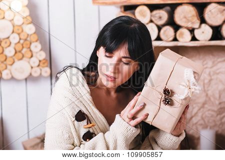 Thoughtful Girl With A Wrapped Christmas Gift
