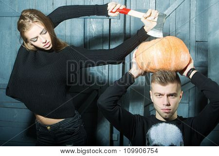 Couple With Axe And Pumpkin
