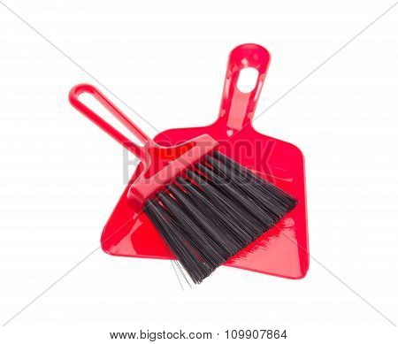 Red brush and plastic dustpan