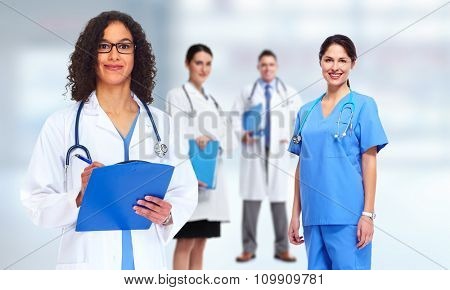 Medical doctor pharmacist woman over blue background.