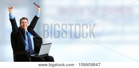 Happy laughing businessman over blue banner background.