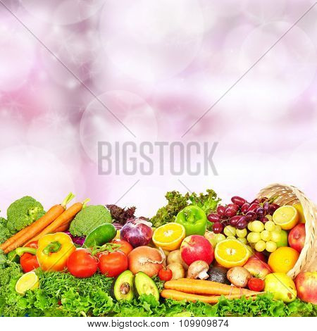 Fresh Vegetables and fruits over abstract background. Healthy diet.