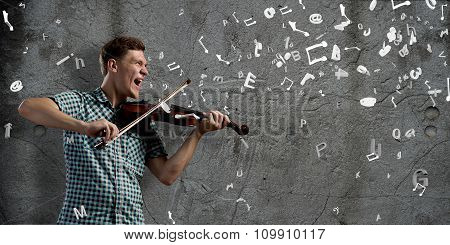 Young handsome guy with violin