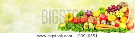 Fresh Vegetables and fruits over green background. Healthy diet.