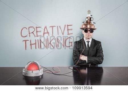 Creative thinking concept with vintage businessman and calculator