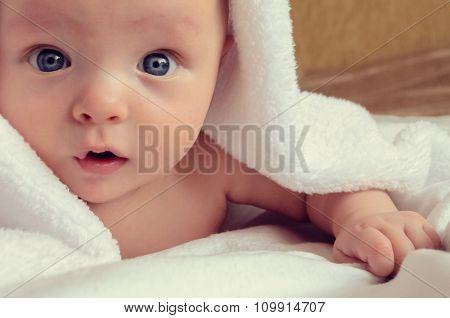 Surprised Baby Under Blanket