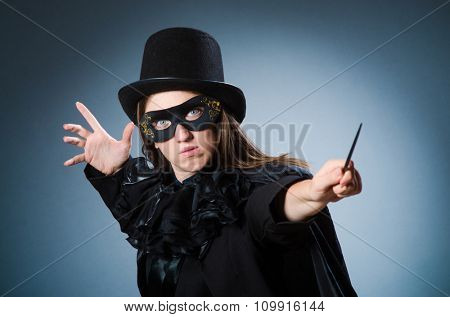 Woman magician in funny concept