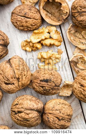 Raw walnuts in shell on wooden bench