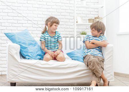 indoor portrait of two young kids, brother and sister, at home