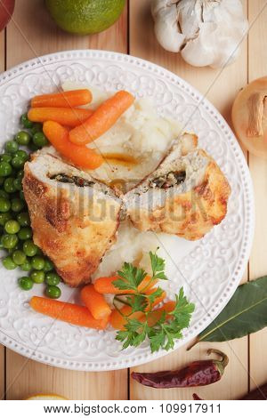 Chicken Kiev, breaded chicken breast stuffed with herbs and butter