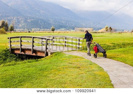 Golf Player And Wooden Bridge