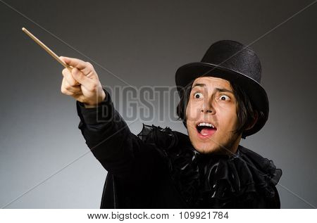 Funny magician wearing cylinder hat