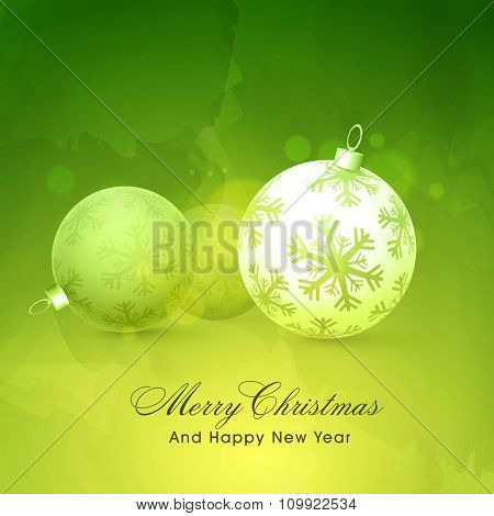 Beautiful glossy Xmas Balls decorated with snowflakes on shiny green background for Merry Christmas and Happy New Year celebration.