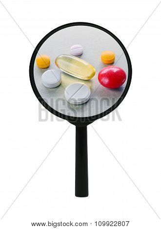 Pills And Tablets Under A Magnifier