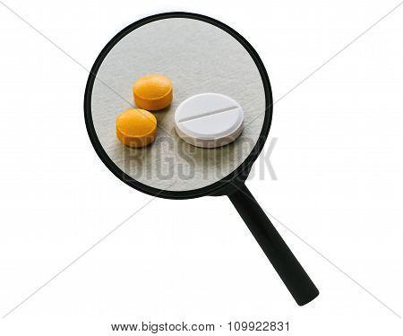 Tablets Under A Magnifier