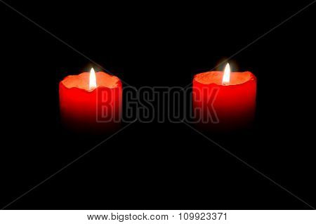 Two Red Candles Burning In The Darkness