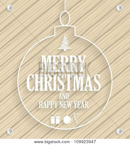 Christmas greeting card in christmas ball on wooden background