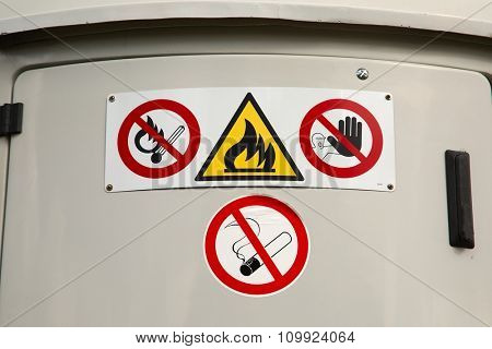 Flammable material container warning signs