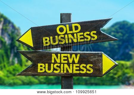 Old Business - New Business signpost in a beach background