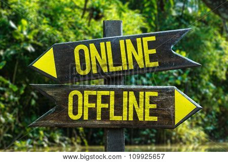 Online - Offline signpost with forest background