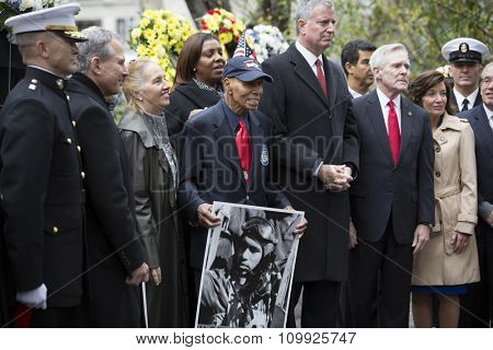 NEW YORK - NOVEMBER 11 2015: Roscoe Brown, 93, pilot with famed Tuskegee Airmen with other VIP at the Eternal Light Monument in Madison Square Park before the Americas Parade on Veterans Day.