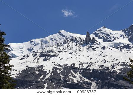 View Of Mountain Rocks And Ice-capped Swiss Alps Near Oeschinensee (oeschinen Lake), On Bernese Ober