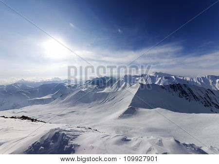 View On Off-piste Slope And Sky With Sun