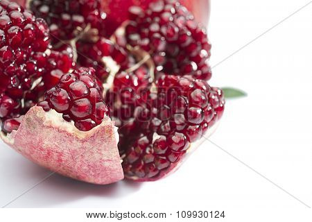 Cross section of a pomegranate isolated on white background.
