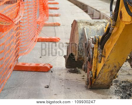Mechanical Arm Of The Excavator Digging On The Road