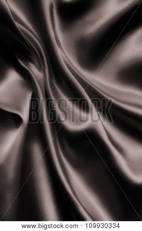 Smooth Elegant Dark Brown Silk Or Satin As Background. In Sepia Toned. Retro Style