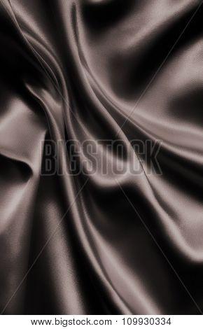 Smooth Elegant Dark Brown Silk Or Satin As Background. In Sepia Toned. Retro Style
