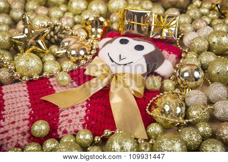 Christmas Background With Gold Balls And Monkey On Red Sox.