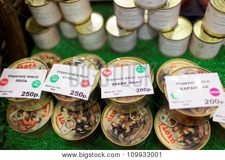 ST. PETERSBURG, RUSSIA - NOVEMBER 18, 2015: Canned meat in the International food exhibition PeterFood. The exhibition is setting up contacts between food manufacturers and retail networks