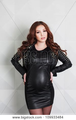 Pregnant woman in rock style