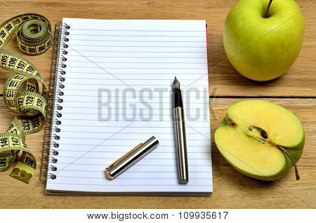 Notebook With Green Apple Fruit And Centimeter