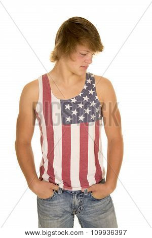 Young Man In Striped Tank Top Hands In Pockets
