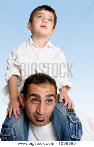 Child Sitting On Father'S Shoulders